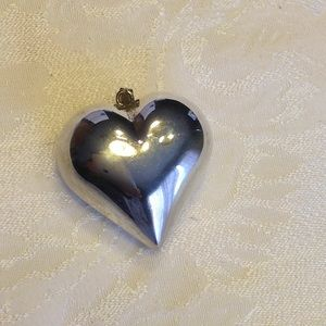 Silver puffed heart pendant.